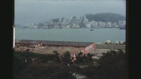 Hong Kong Building Site. HONGKONG, KOWLOON, MAY 1978. POV Establishing Pan Shot From The Sheraton Hotel Overlooking A Large Building Site By The Waterfront Of stock video