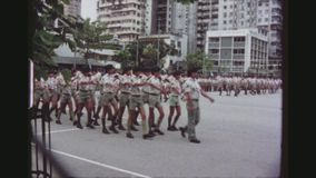 Scouts Parade. HONGKONG, KOWLOON, MAY 1978. Two Shot Sequence Of Many Young Boy Scouts Marching On A Big Square Performing A Ceremony For The Scout Association stock footage