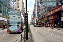 Hongkong Mongkok shopping street. A sight of Hongkong Mongkok shopping street, as buildings and bus, shown as city view and transportation, and people business Royalty Free Stock Image