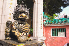 HONGKONG ne of Two Dragon Bronze Statue at Main Entrance to Sik Sik Yuen Wong Tai Sin Temple. Stock Image