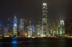 Hongkong - night cityscape. Hongkong, famous business city - nightscape with beautiful lights from highest skyscraper and reflections from harbour Stock Photo