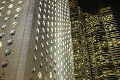 Hongkong office buildings by night. Hongkong city center with modern architecture by night. Bright office buildings with light inside Royalty Free Stock Photos