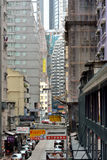 Hongkong old small street among modern an aged buildings Royalty Free Stock Images