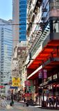 Hongkong shopping street in city. A sight of Hongkong center area street traffic, as buildings and bus, shown as city view and transportation, and people Stock Photo