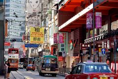 Hongkong shopping street. A sight of Hongkong center area street traffic, as buildings and bus, shown as city view and transportation, and people business living Stock Photo