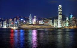 Hongkong skyline. Hongkong island panorama and fast boat seen from Kowloon peninsula Stock Images