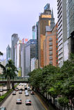 Hongkong street and buildings. View of a street and traffic in Hongkong, including street, vehicle and ad board, shown as city living environment in Hongkong Stock Photos