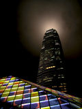 HongKong Two International Finance Center. HongKong Two International Finance Centre tower by night with a colorful artwork Stock Photos
