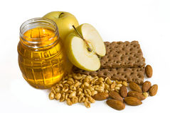 Honig, Äpfel und Muttern Stockfotos