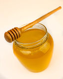 Honig auf einem Weiß Stockfotografie