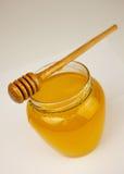 Honig auf einem Weiß Stockbilder