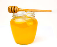 Honig auf einem Weiß Lizenzfreie Stockfotografie