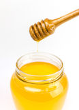 Honig auf einem Weiß Stockbild