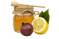 Honig in der Glasgefäßzitronenzwiebel Stockfotos