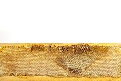 Honig mit Bienenwabe auf Holztisch Stockfotos