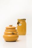Honig-Potenziometer und Glas im Hintergrund Stockbild