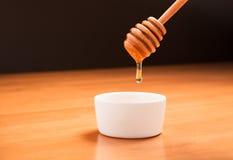 Honig-Schöpflöffel Stockfoto
