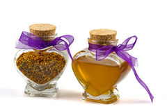 Honig- und Blütenstaubglas Stockfotografie