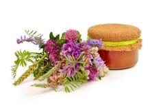 Honig und Blumen Stockfoto