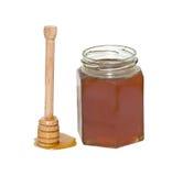 Honig und Honigschöpflöffel (Honigsteuerknüppel) Stockfoto