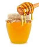 Honig und Schöpflöffel Lizenzfreie Stockfotografie
