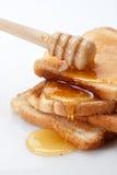 Honig und Toast stockfoto