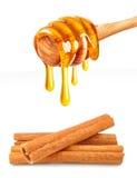 Honig und Zimt stockfotos