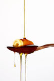 Honiggießen Stockbild