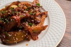 Honigpaprikakartoffel oder Kartoffelkeile lizenzfreie stockfotografie