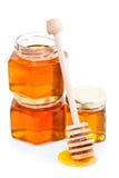 Honigschöpflöffel mit Honig stockfotos