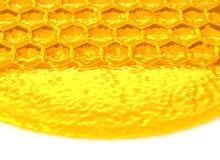 Honigzellen mit Honig Stockfoto