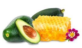 Honing en avocado die op wit wordt geïsoleerd Stock Fotografie