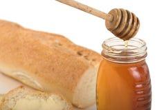 Honing en baguette stock foto's