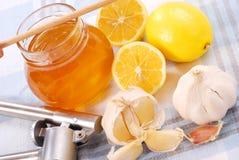 Honing, knoflook en citroen Royalty-vrije Stock Foto's