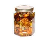 Honing met noten en gedroogd fruit Royalty-vrije Stock Fotografie