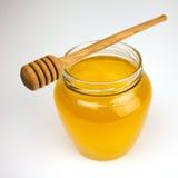 Honing op een wit Royalty-vrije Stock Afbeeldingen