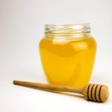 Honing op een wit Royalty-vrije Stock Fotografie
