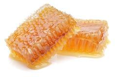 Honingraat die op wit wordt geïsoleerd stock afbeeldingen