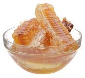 Honingraat in glaskop stock afbeelding