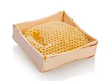 Honingraat op witte backgground stock afbeelding