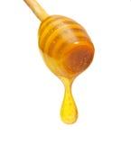 Honingsdruppel van houten dipper royalty-vrije stock foto