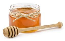 Honingspot op geïsoleerde witte achtergrond Stock Foto