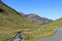 Honister Pass road and Gatesgarthdale Beck Cumbria. Stock Photography