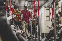 Honk Kong November 2018 - folk i tunnelbana arkivbilder