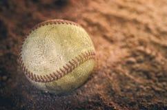 Honkbal op grond Royalty-vrije Stock Afbeelding