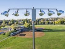 Honkbalvelden en lichten Royalty-vrije Stock Afbeelding