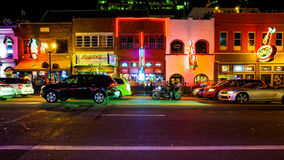 Honky Tonk Bars and Nightlife on Broadway Street in Nashville, T. Nightlife on Broadway Street in Nashville, Tennessee at night with traffic and neon lights Royalty Free Stock Images