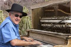 Honky Tonk Piano Player in Desert royalty free stock image