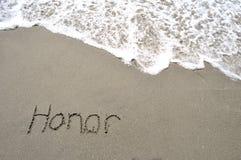 Honneur dans le sable Images stock