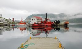 Norway - Honningsvag Harbour - Colored fishing boats with fog  Stock Photography